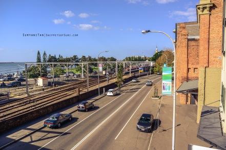Newcastle city. At a bridge overlooking train tracks.